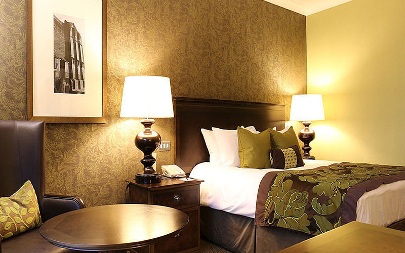 A double room with brown, cream and lime green interiors
