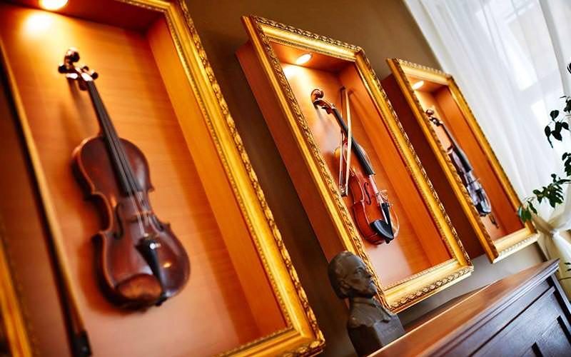 Framed violins on a wall
