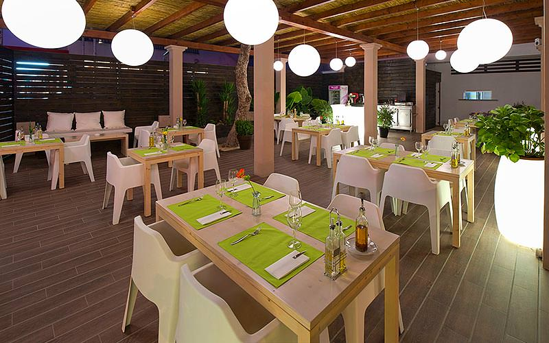 An al fresco dining area at Marvell Club, at night