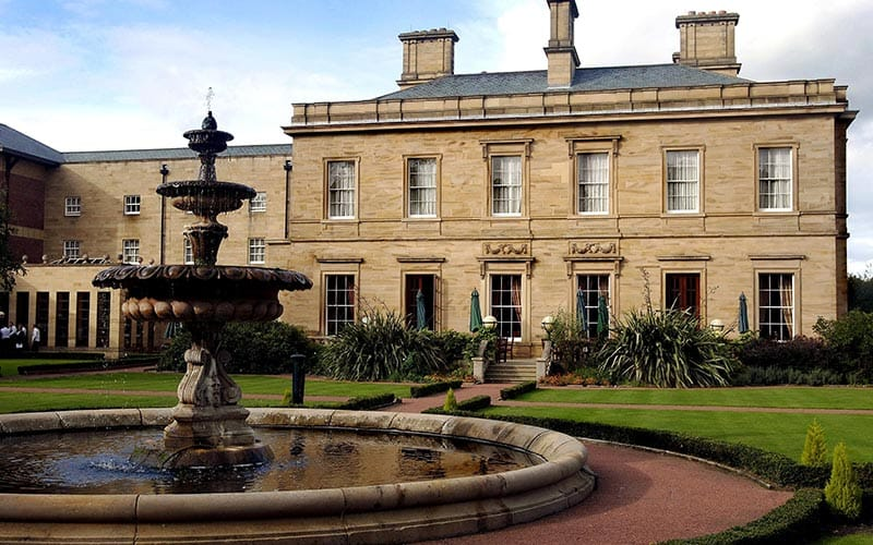 A fountain in front of the back exterior of Oulton Hall