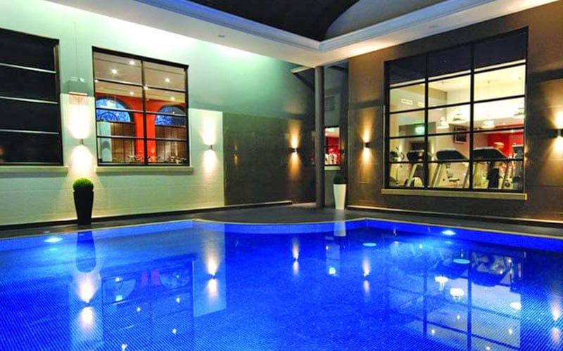 An indoor pool lit up