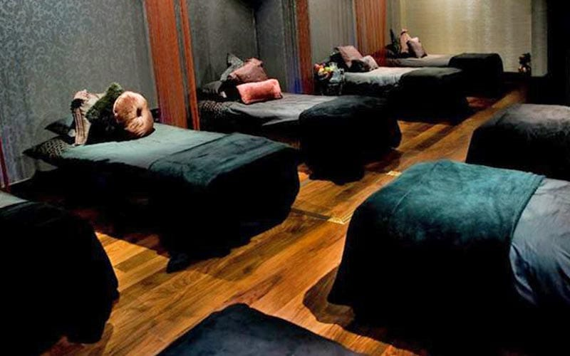 Black massage beds in a beauty treatment room