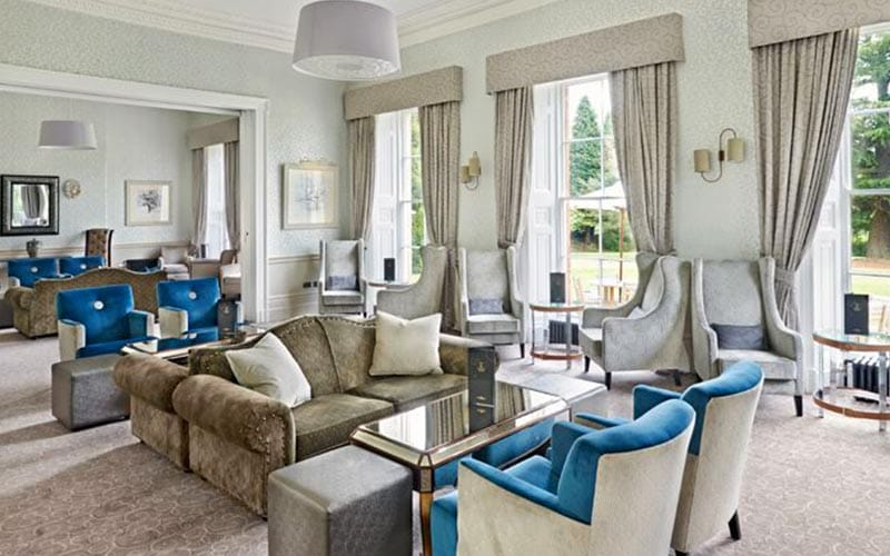 Sofas and chairs in a lobby at Mottram Hall
