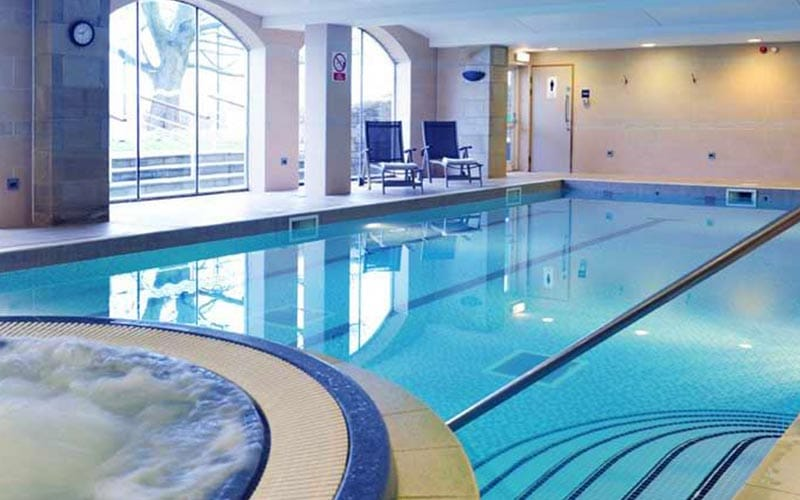 A bubbling Jacuzzi and a swimming pool in Tankersley Manor