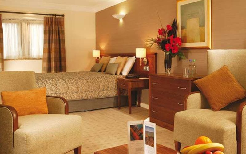 A bedroom with comfy seating in Tankersley Manor