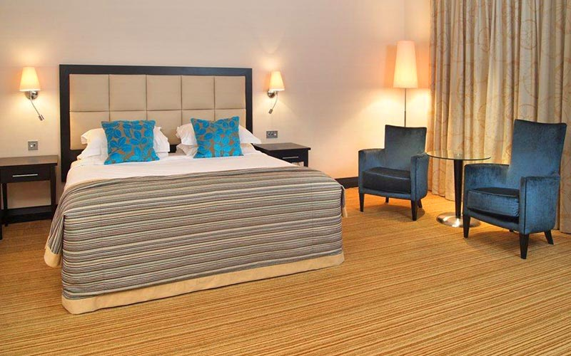 A double room in The Nottingham Belfry with blue feature cushions