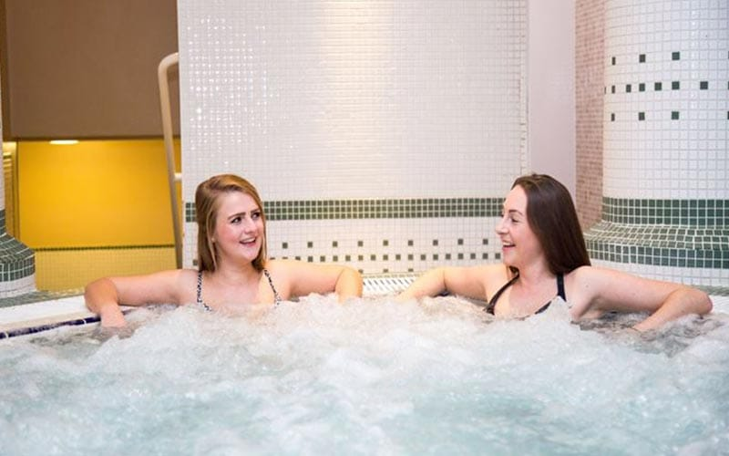 Two women sat in the Jacuzzi at Dunston Hall