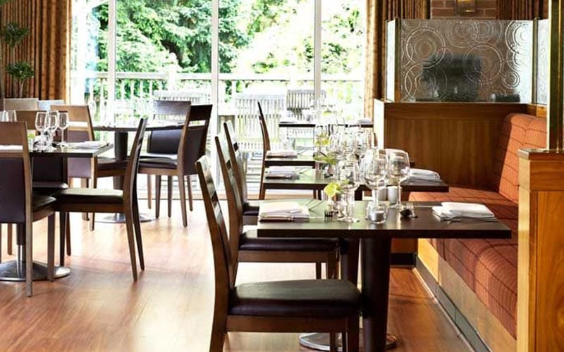 Tables and chairs at the hotel restaurant at Bridgewood Manor