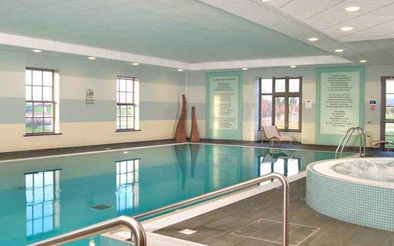 The swimming pool and Jacuzzi area of The Cambridge Belfry