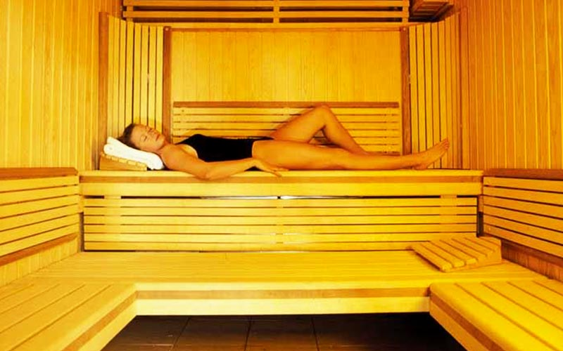 A woman relaxing in a sauna