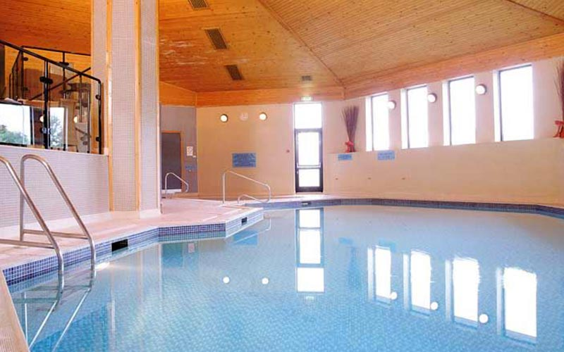An indoor pool at Bridgewood Manor