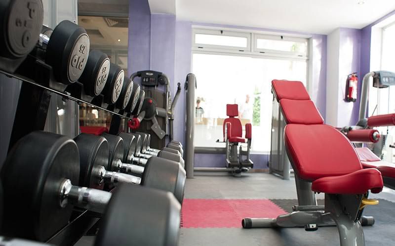 Work out equipment in a purple gym