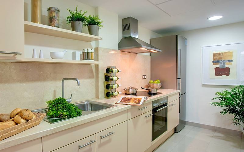 White kitchen counters topped with appliances and food