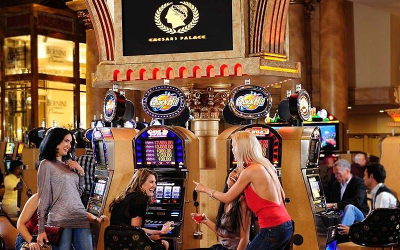 People playing on slot machines at the Caesars Palace casino