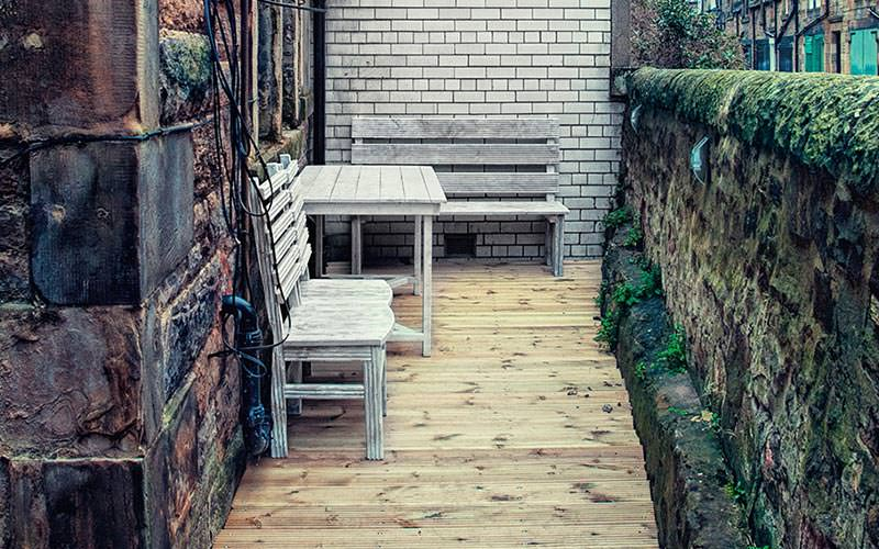 An outdoor seating terrace with wooden decking