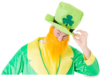 A man dressed in an Irish outfit, tipping his hat