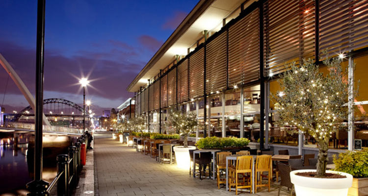 Image of the outside seating area with the view of the tyne bridge