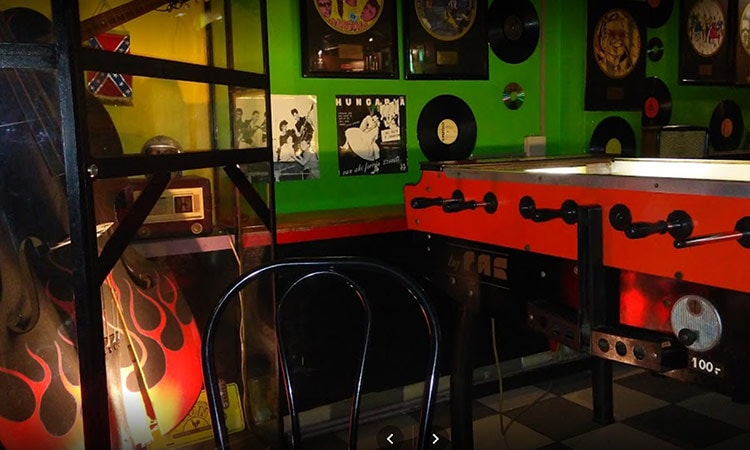 A foosball table in Amigo Bar with records on the wall