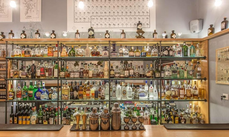 A medicine cabinet of drinks behind the bar in Bar Pharma