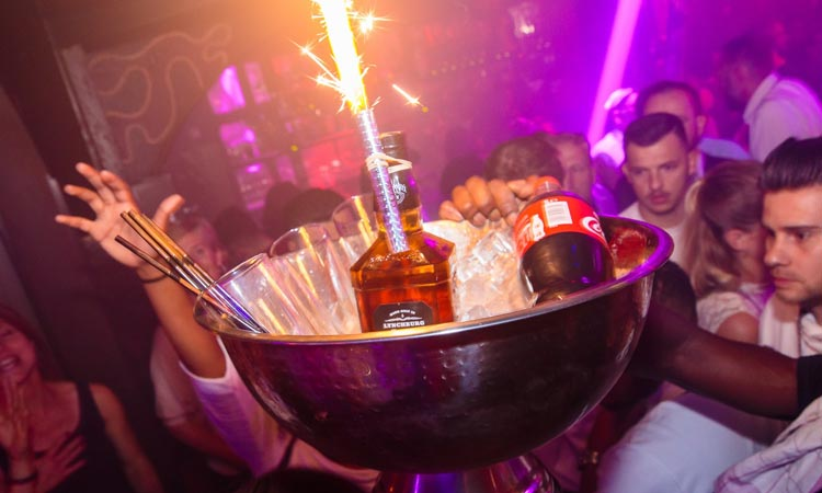 A bucket of alcohol with sparklers in, in Club Smokey