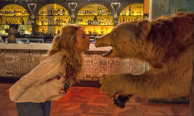 A girl pretending to kiss a bear in The Liquor Rooms in Dublin