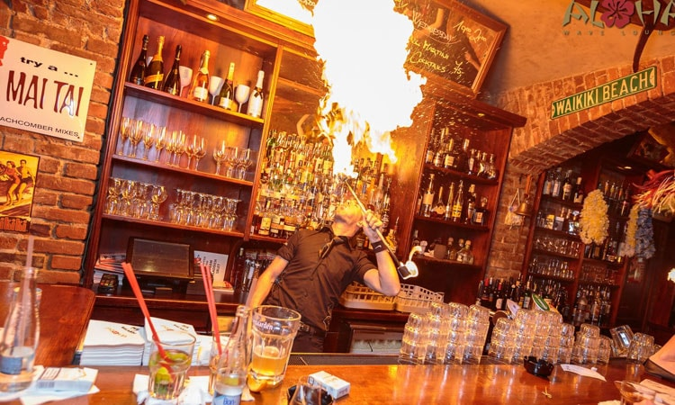 A man breathing fire in Aloha Bar