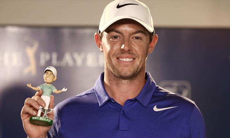 Rory McIlroy holding up a bobble head