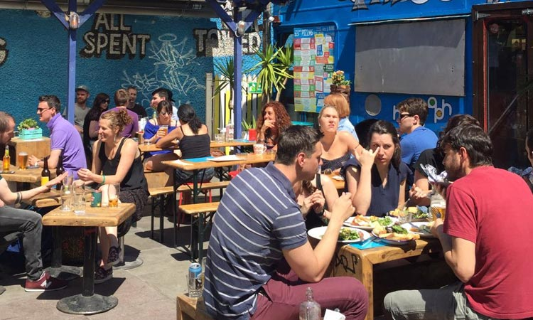 People sat in the beer garden of The Bernard Shaw