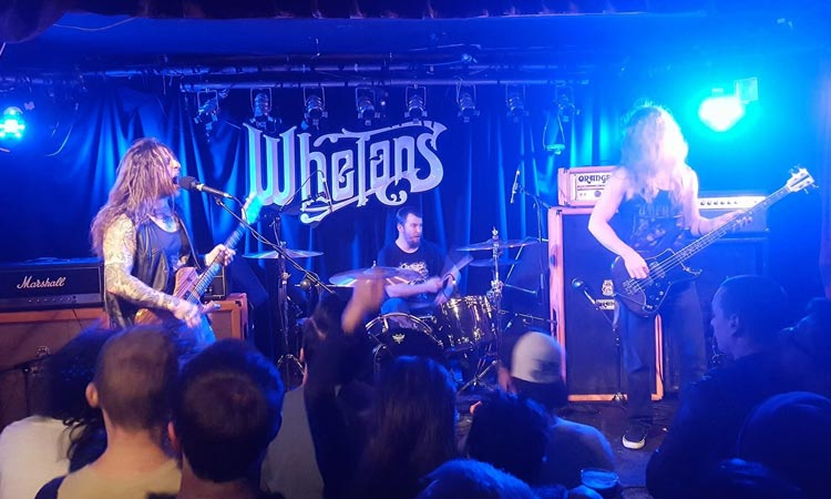 A band performing on stage at Whelan's