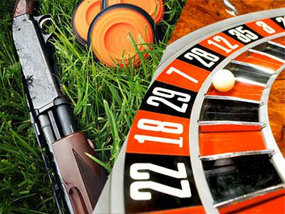 Split image of a shotgun in grass next to orange clays, and a white ball on a roulette wheel