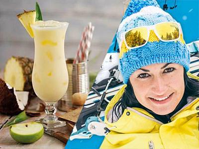 Pina Colada cocktail and woman in ski clothes