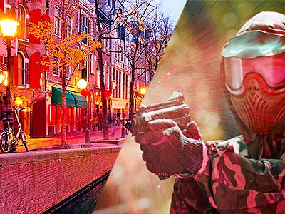 Lit-up buildings along a canal, and a man in camouflage gear and mask, aiming with a paintball gun