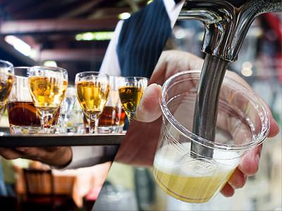 A split image of some beers in a sampling tray and a small glass of beer being poured