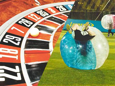 Split image of a white ball on a roulette wheel, and a man upside down in an inflatable zorb