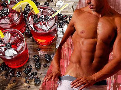 Split image of red drinks topped with ice and set on a table surrounded by berries, and a mans naked torso and his hands pulling down his white boxers
