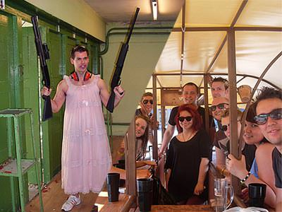 Split image of a man holding two guns in a pink dress, and men and women posing for a photo