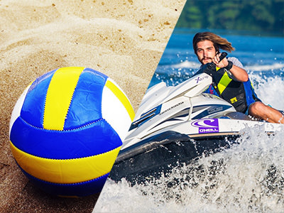A volleyball in sand and a man on a jetski
