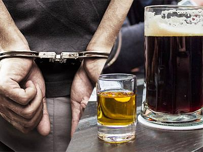 Split image of a man's hands in handcuffs and a pint of beer next to a shot