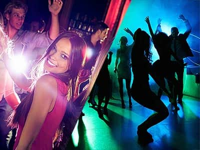 Split image of a woman dancing in a club with people in the background, and people dancing in a club to a backdrop of blue and green light