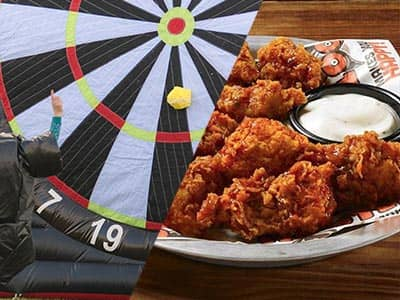 Split image of a man kicking a ball at a huge dart board, and a plate of chicken wings