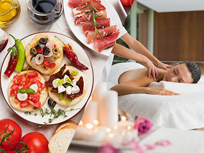 A selection of tapas on a table and a woman receiving a massage