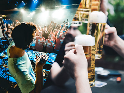 A man Djing and a group of men holding large pints of beer
