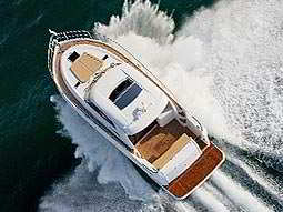 An areal shot of a boat driving through the water