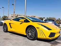 A yellow Lamborghini parked up outside