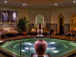The interior of a spa with a lit up swimming pool