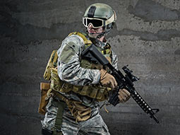 A man in camouflage holding an airsoft gun