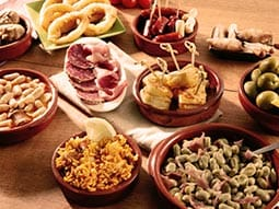 Image of round dishes filled with tapas