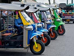 Image of parked tuk tuks in a line