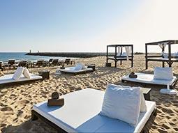 A beach with various sunbeds
