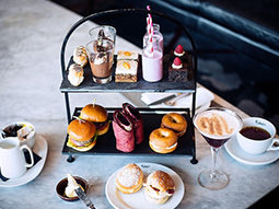 A tray of cakes with a cocktail